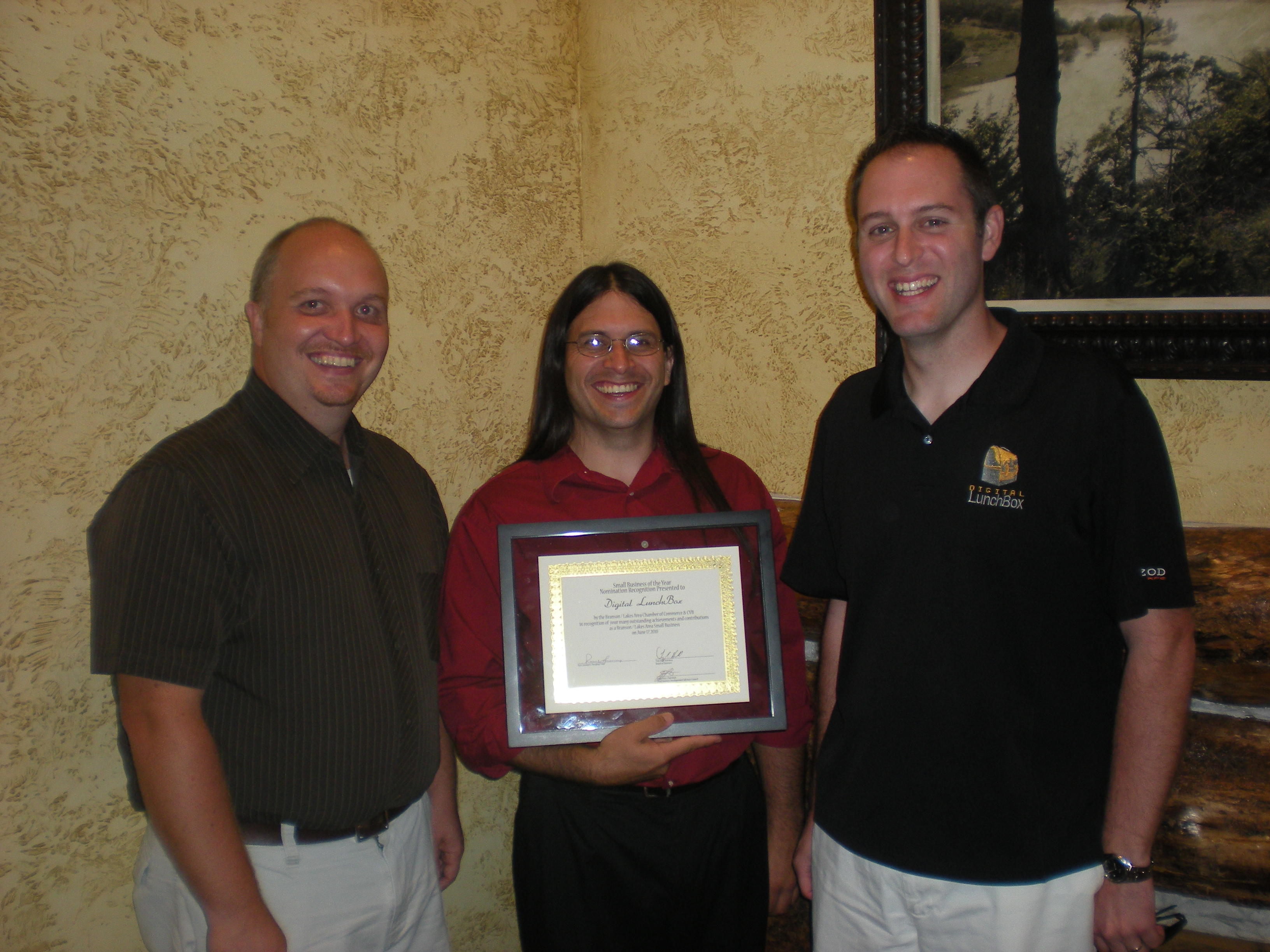Josh, Jesse, and Jason Accepting 2010 Branson Chamber of Commerce Small Business of the Year Nomination